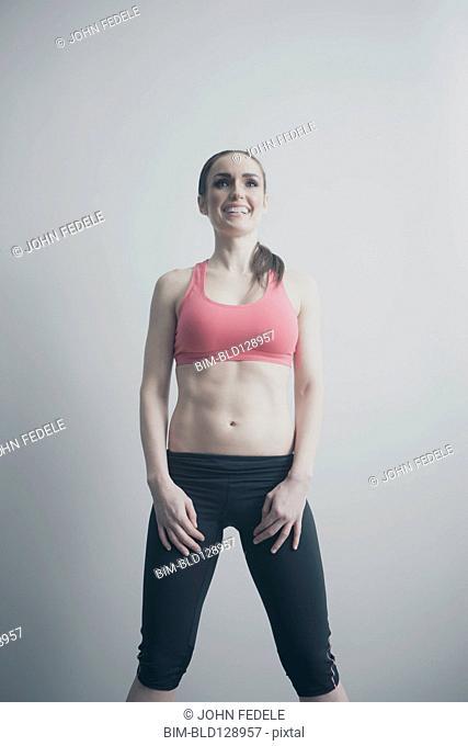 Smiling Caucasian woman in sportswear