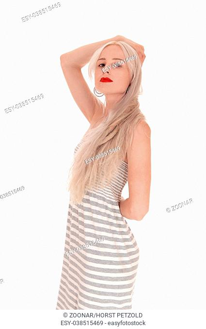 Lovely blond woman standing in profile