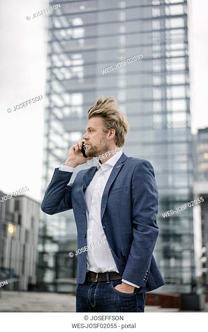 Businessman on cell phone in the city