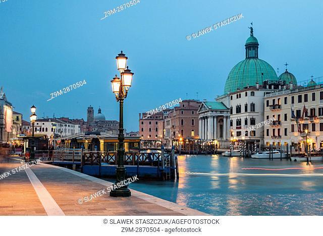 Night falls on Grand Canal in Venice, Italy. San Simeone Piccolo church dome tower above Santa Croce district
