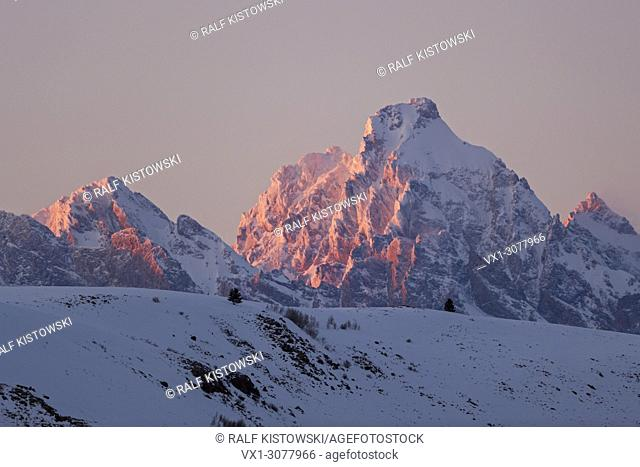 Grand Teton Range in winter, in last evening light, snow covered, at sunset, Grand Teton National Park, Wyoming USA