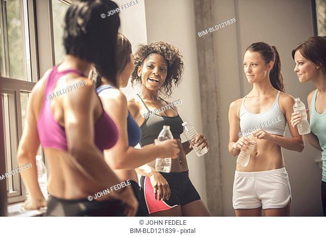 Women talking in gym