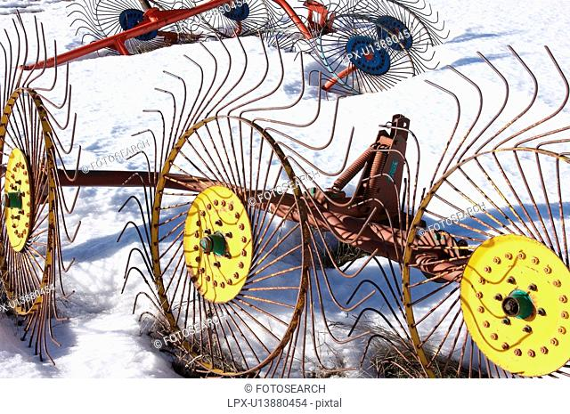 hay making tools left in the snow over the winter, in meadow of Piano Grande, Umbria