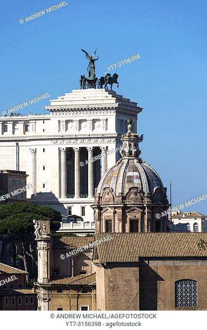 Monument to Vittorio Emanuele II with the dome of the Church of Santi Luca e Martina. Rome. Italy