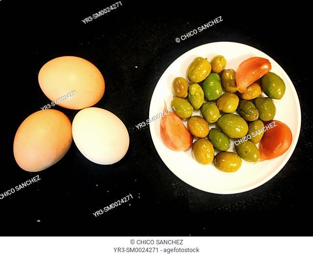 Free range eggs and olives with garlic in Prado del Rey, Sierra de Cadiz, Andalusia, Spain