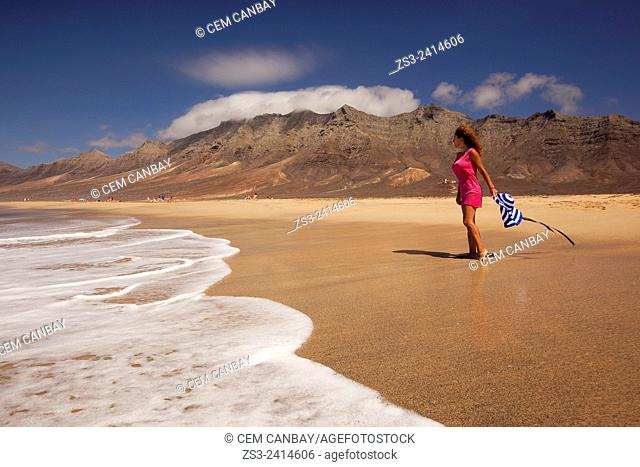 Woman walking on the beach of Cofete, Fuerteventura, Spain, Europe