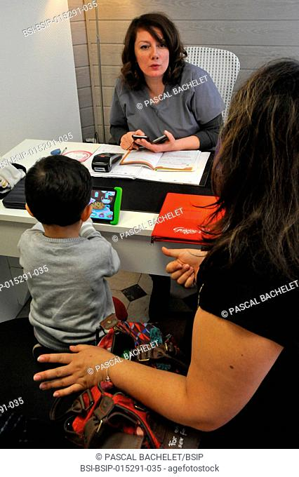 Reportage in an independent midwife practice in Ham, in the Somme region of France. Consultation with a pregnant woman, with her son