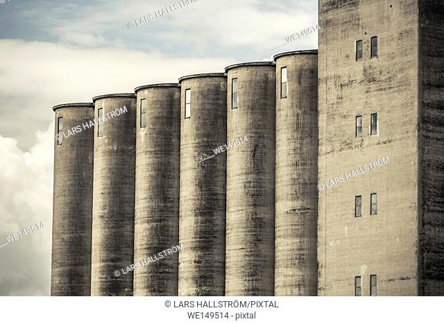 Exterior of old industrial building. Concrete architecture. Abandoned factory