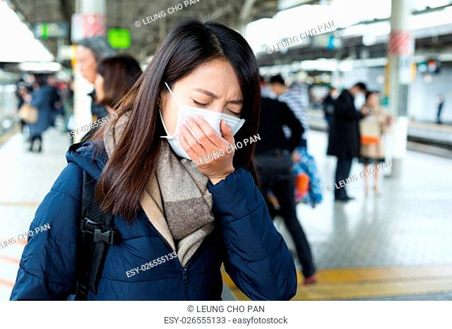 Woman feeling sick in train platform