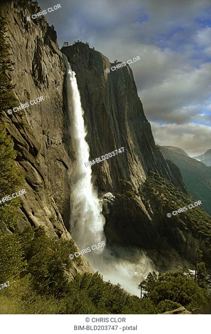 Waterfall over rock formations, Yosemite, California, United States