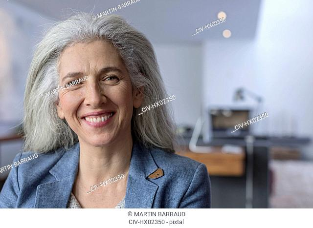 Portrait smiling, confident mature woman