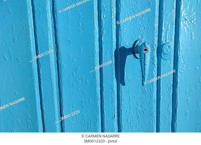 Blue wooden door and handle