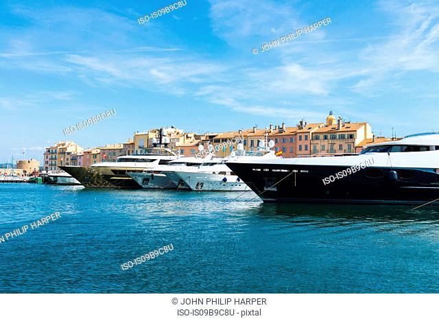 Superyachts moored on waterfront, St Tropez, Cote d'Azur, France