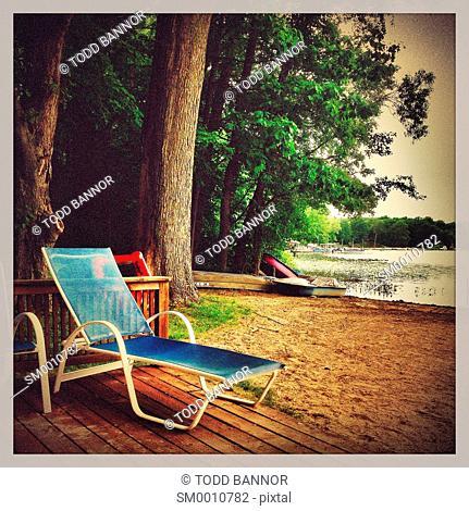 Chaise lounge beach chair. Clear Lake, Michigan