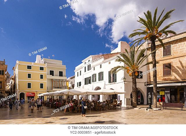 People sitting outside a bar in Ciutadella de Menorca , Menorca , Balearic Islands , Spain