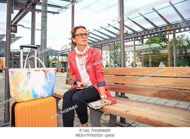 Young woman waiting at bus station