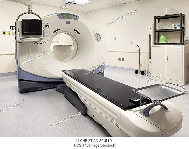 A city hospital. The scanning department. A large MRI magnetic resonance imaging scanner, with a patient bed. A large round mechanism, with monitor and screen