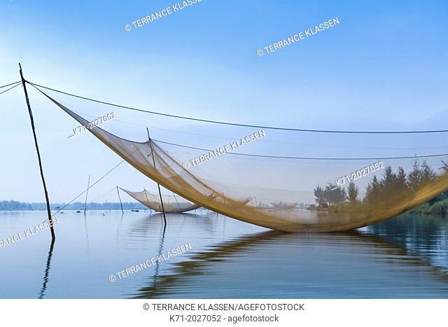 Large fishing nets in the Thu Bon River near Hoi An, Vietnam, Asia