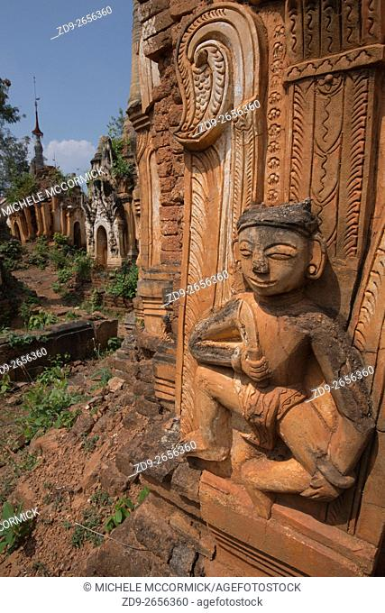 A Hindu figure is a decorative element on one of the hundreds of stupas at Indein near Inle Lake