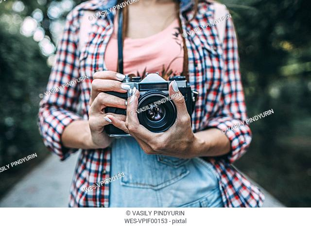Close-up of woman with a camera
