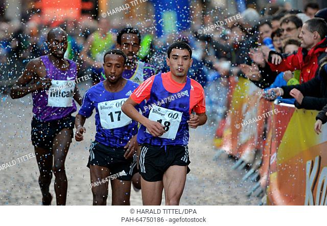 Micah Kogo of Kenia, Haymanot Alew of Ethiopia, Teklit Tesfaghabr of Eritrea and Zakaria Boudad of Marocco in action during the men's 8-kilometre race at the...