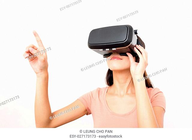 Young woman watching movie with virtual reality