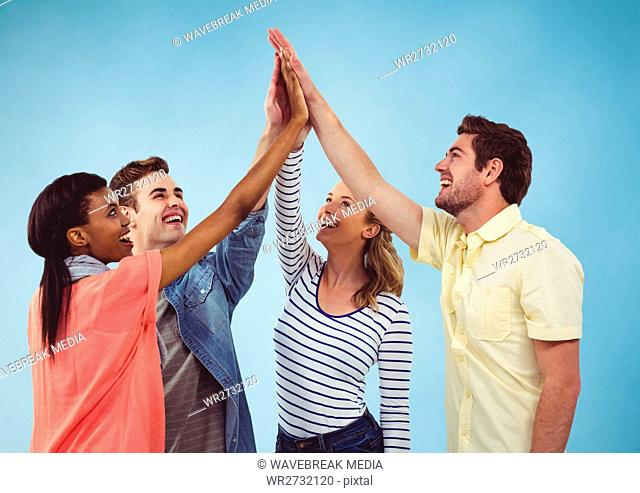 Group of Friends clapping each other hands against a blue background