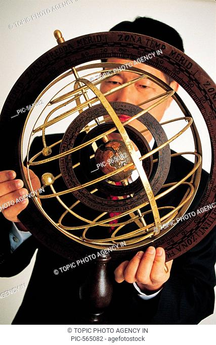 Businessman And Armillary sphere
