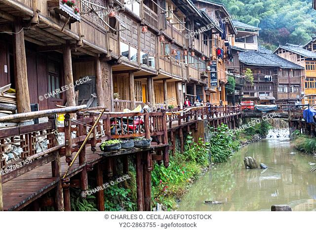 Zhaoxing, Guizhou, China, a Dong Minority Village. Houses Line the Small River Running through the Village