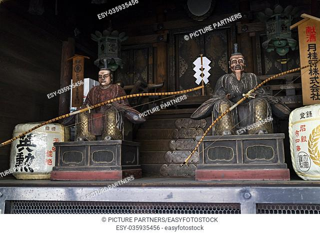 Kyoto, Japan - Traditional wooden sculptured Gate-keepers at a shrine in the Shijo-dori