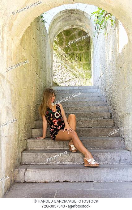 Beautiful woman posing for the camera in Livadia Palace in Alupka, Crimea