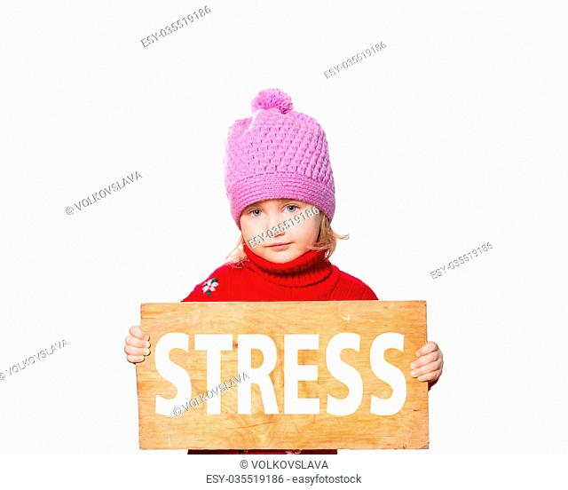 Little girl holding Board with inscription Stress. Isolated on white background