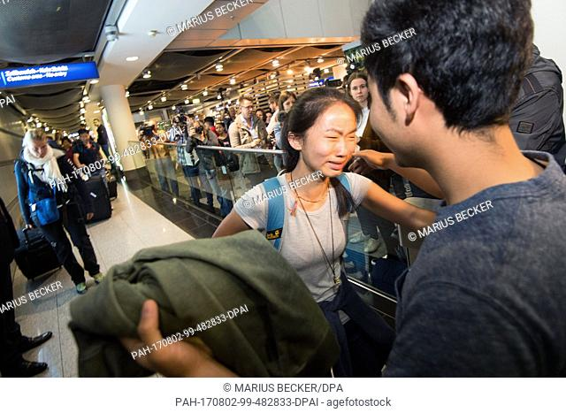 Schoolgirl Bivsi Rana arrives to the airport and is greeted by her brother Biswash in Dusseldorf, Germany, 02 August 2017