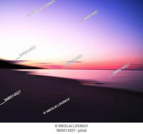 Horizontal dramatic sunset on lake abstract background