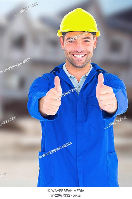 Construction Worker with thumbs up in front of construction site