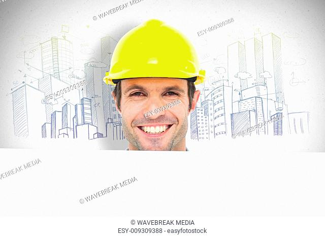 Composite image of happy architect with bill board over white background
