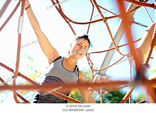 Woman rope climbing in park