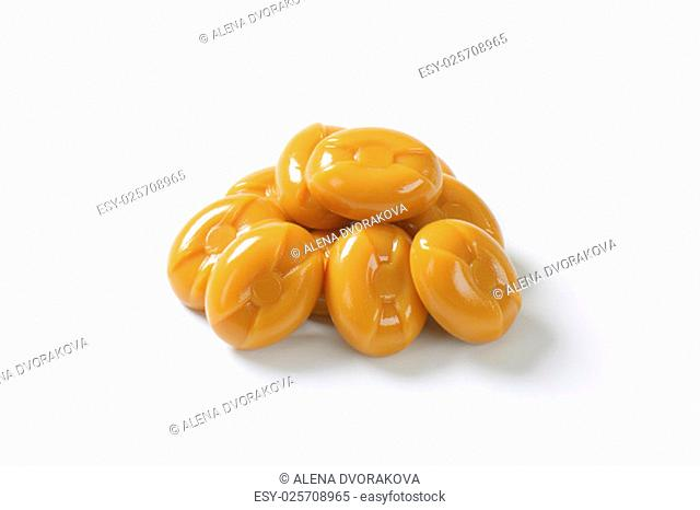 handful of caramel candies on white background