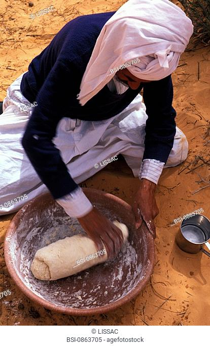 AFRICA, FOOD<BR>Photo essay for press only.<BR>Bedouin kneading bread in the Sahara desert, Tunisia