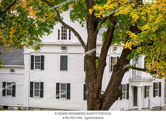 House with a tree in front of it in Wiscasset, Maine