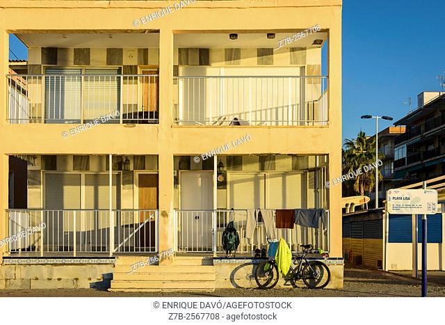 A yellow house view in Playa Lisa beach, Alicante coast, Spain
