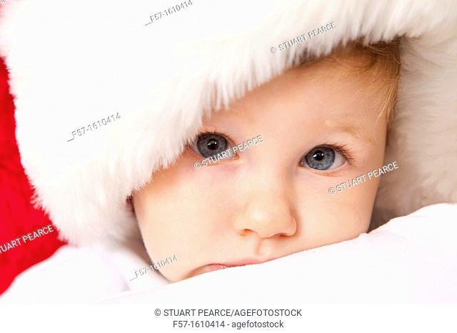 One year old boy wearing a Santa hat