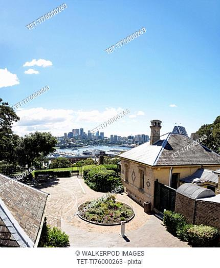 Australia, New South Wales, Sydney, Courtyard of house with city skyline in background