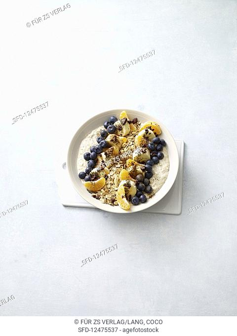 Cold brew porridge with fruit and cocoa nibs