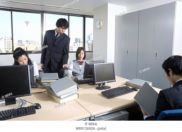 Manager scolding office worker