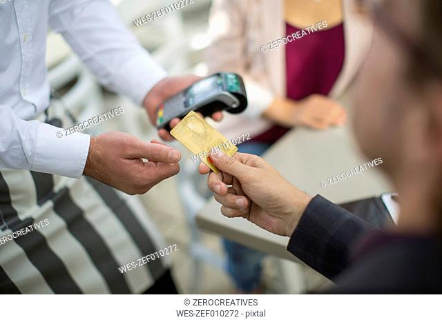 Customer paying with credit card in restaurant