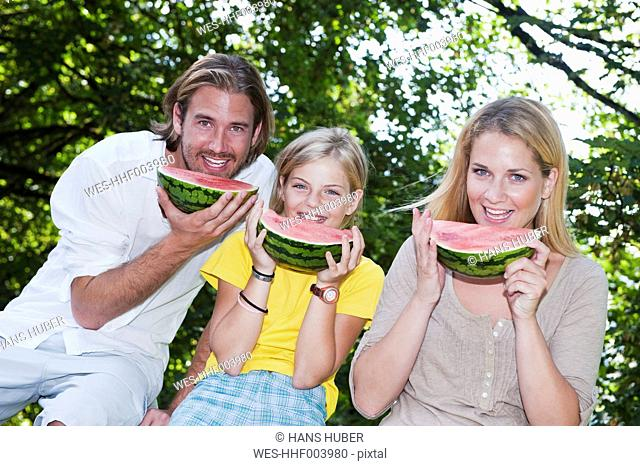 Austria, Salzburg County, Family eating watermelons