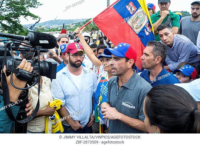 Miranda state governor and political leader Henrique Capriles Radonsky speaks to demonstrators on the freeway. Venezuelan citizens