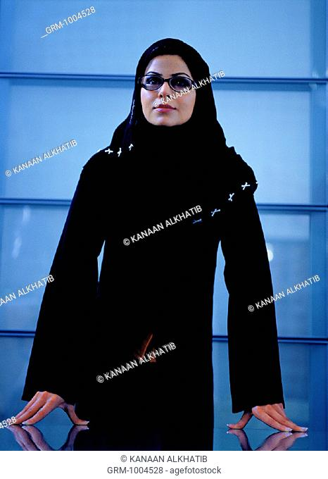 Arab businesswoman standing at boardroom table
