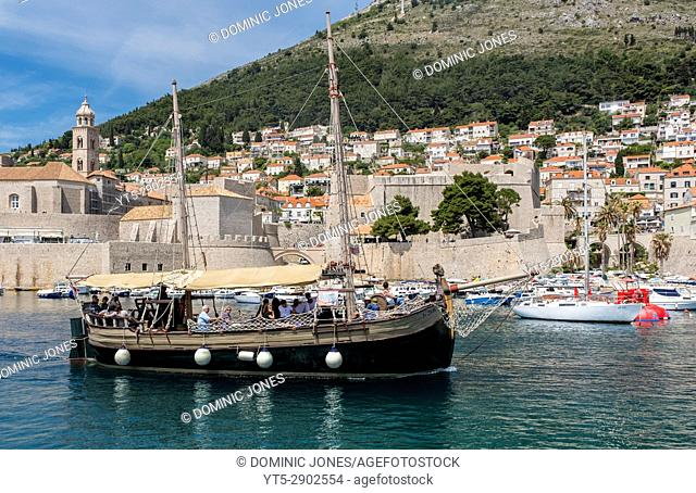 A tourist cruise leaves the port of The Old City, Dubrovnik, Croatia, Europe